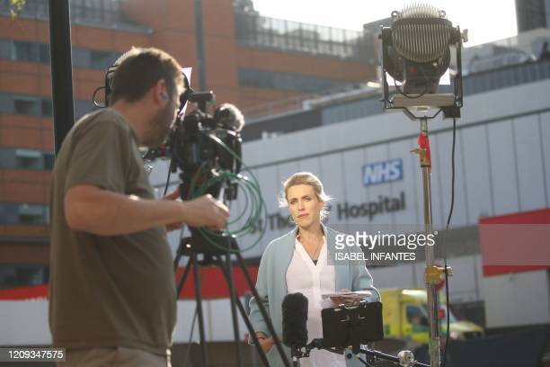 Journalists work outside St Thomas' Hospital in central London on April 7 where Britain's Prime Minister Boris Johnson is in intensive care with...