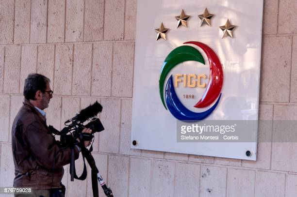 Journalists work outside the Italian Football Federation headquarters for the meeting of the Federal Council where the President Carlo Tavecchio has...