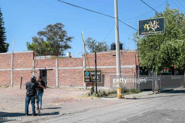 Journalists work outside the nightclub where at least 15 men were killed in an attack in Salamanca Guanajuato state Mexico on March 9 2019 At least...