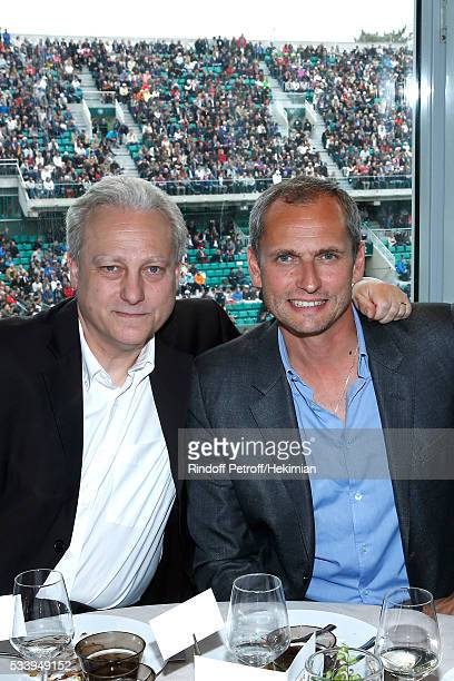 Journalists Yves Bigot and Louis Laforge attend the 'France Television' Lunch during the 2016 French Tennis Open Day Three at Roland Garros on May 24...