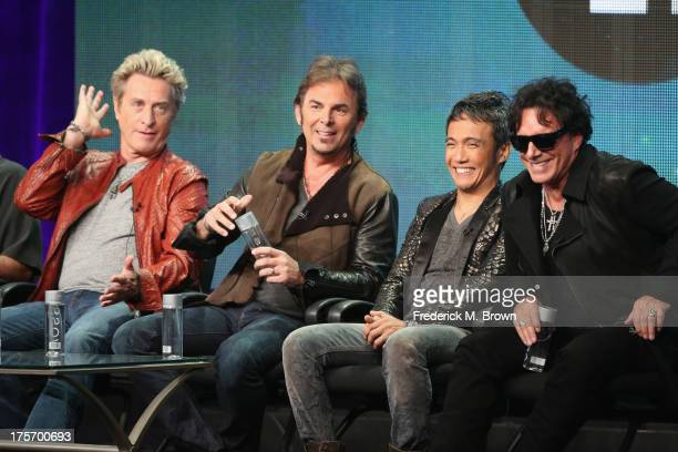 Journey band members bassist Ross Valory keyboardist Jonathan Cain lead vocalist Arnel Pineda and guitarist Neal Schon speak onstage during the...