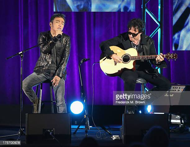 Journey band members lead vocalist Arnel Pineda and guitarist Neal Schon perform onstage during the Don't Stop Believin' Everyman's Journey panel at...
