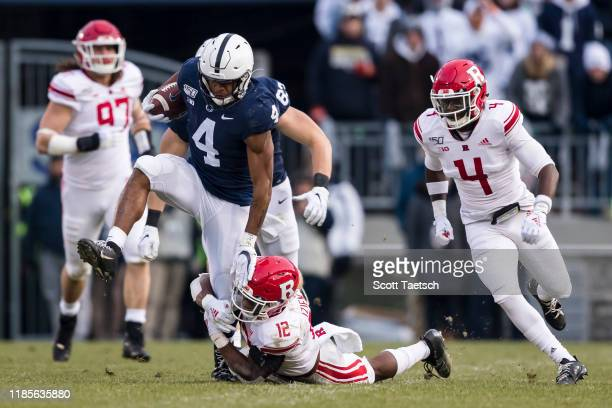 Journey Brown of the Penn State Nittany Lions carries the ball as Christian Izien of the Rutgers Scarlet Knights defends in the first half at Beaver...
