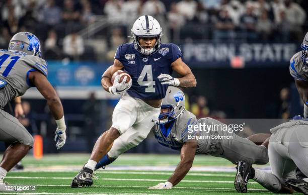 Journey Brown of the Penn State Nittany Lions runs the ball during the Goodyear Cotton Bowl Classic at ATT Stadium on December 28 2019 in Arlington...