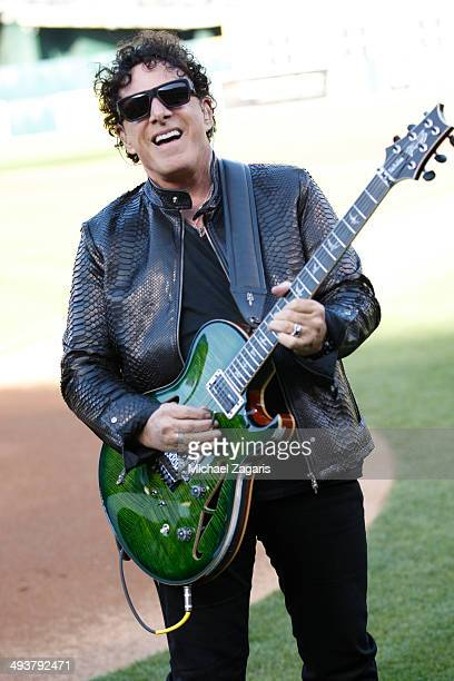 Journey guitar player Neal Schon performs the anthem prior to the game between the Washington Nationals the Oakland Athletics at Oco Coliseum on May...