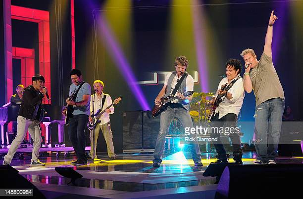Journey members Arnel Pineda Ross Valory and Neal Schon and Rascal Flatts members Jay DeMarcus Joe Don Rooney and Gary LeVox perform onstage during...