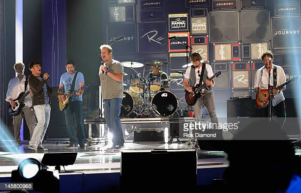 Journey members Ross Valory Arnel Pineda Deen Castronovo and Neal Schon and Rascal Flatts members Jay DeMarcus Gary LeVox and Joe Don Rooney perform...