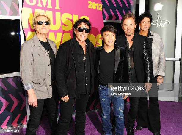 Journey members Ross Valory Neal Schon Arnel Pineda Jonathan Cain and Deen Castronovo arrive at the 2012 CMT Music awards at the Bridgestone Arena on...