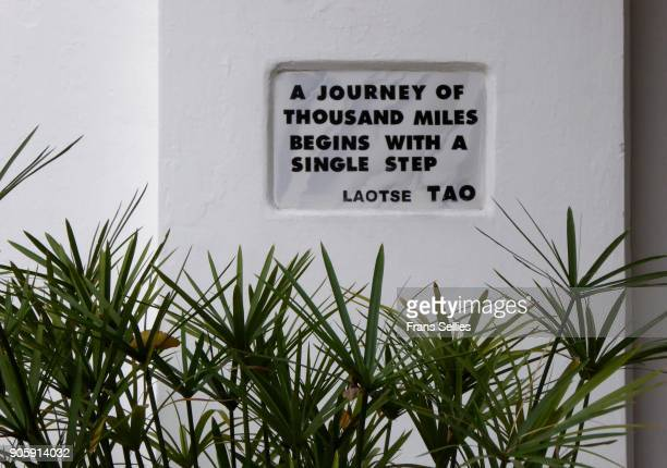 a journey of thousand miles begins with a single step - philosophie stock-fotos und bilder