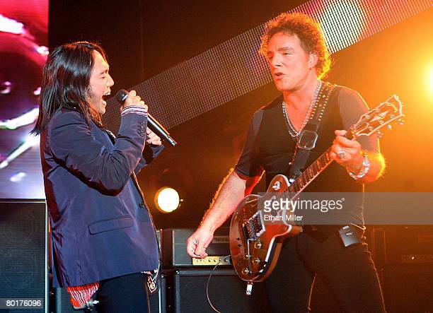 Journey singer Arnel Pineda and guitarist Neal Schon perform at the Planet Hollywood Theatre for the Performing Arts March 8 2008 in Las Vegas Nevada