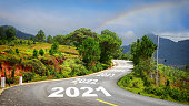 Journey to new year 2021 to 2025 on asphalt road surface with marking lines