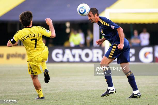 Jovan Kirovski of the Los Angeles Galaxy heads the ball away from Guillermo Barros Schelotto of the Columbus Crew on May 29 2010 at Crew Stadium in...