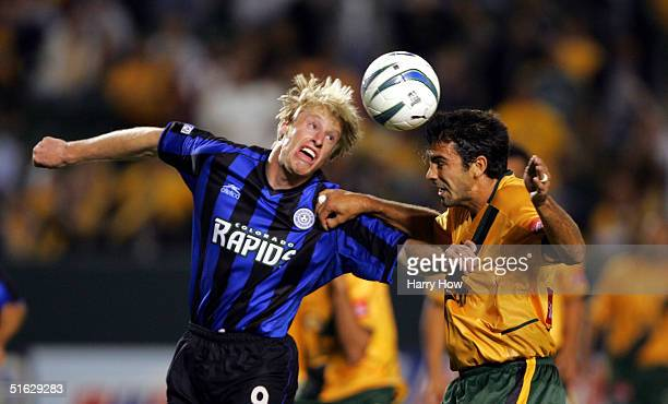 Jovan Kirovski of the Los Angels Galaxy heads the ball as he clashes with Nat Borchers of the Colorado Rapids in the Western Conference Semifinals...