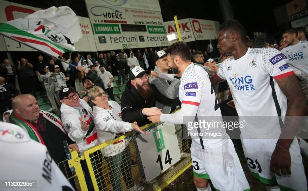 Jovan Kostovski of OH Leuven and Aboubakar Keita of OH Leuven high five the travelling fans after the Proximus League Play Down match between Lommel...