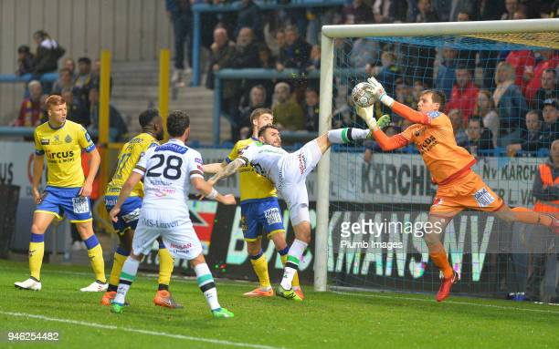 Jovan Kostovski of OH Leuven in action with Davy Roef of WaaslandBeveren during the Belgian First Divison A Europa League Playoffs tie between...