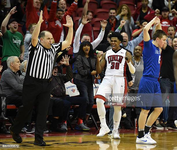 Jovan Mooring of the UNLV Rebels and Jacob Van of the Air Force Falcons react after Mooring hit a 3pointer with no time left in regulation to tie...