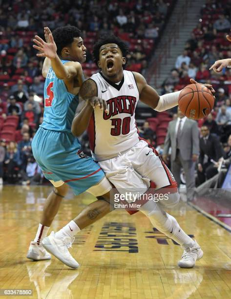 Jovan Mooring of the UNLV Rebels is fouled by Jalen Harris of the New Mexico Lobos during their game at the Thomas Mack Center on February 1 2017 in...