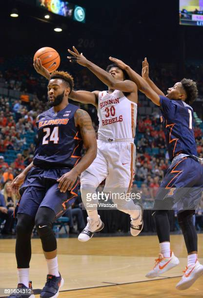 Jovan Mooring of the UNLV Rebels is fouled by Trent Frazier of the Illinois Fighting Illini during their game at the MGM Grand Garden Arena on...