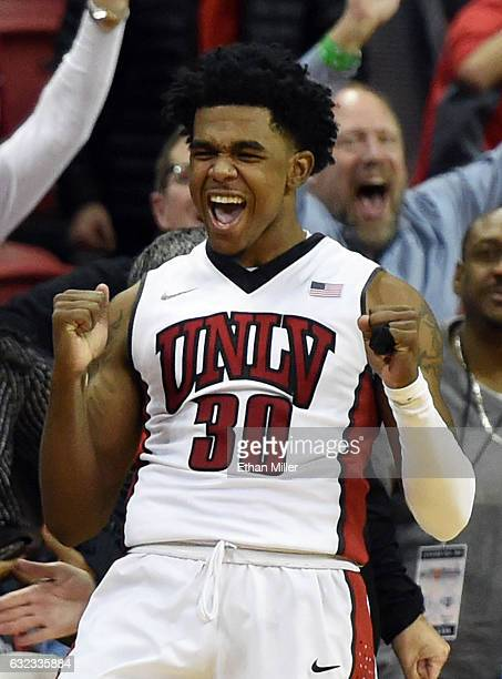 Jovan Mooring of the UNLV Rebels reacts after he hit a 3pointer with no time left in regulation to tie the game against the Air Force Falcons 5858 at...
