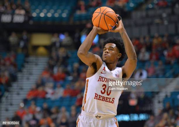 Jovan Mooring of the UNLV Rebels shoots against the Illinois Fighting Illini during their game at the MGM Grand Garden Arena on December 9 2017 in...