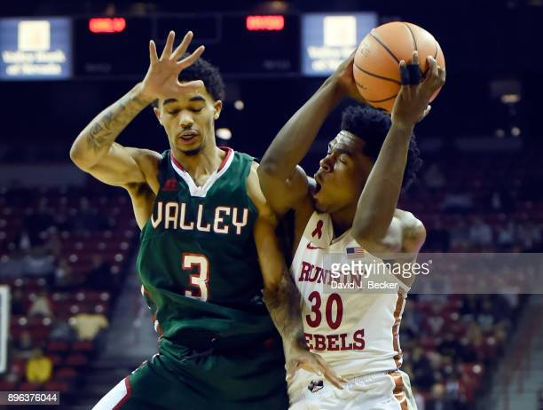 Jovan Mooring of the UNLV Rebels shoots againt Jordan Evans of the Mississippi Valley State Delta Devils during the first period at the Thomas Mack...