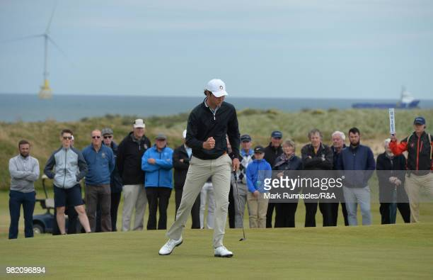 Jovan Rebula of Republic of South Africa reacts after sinking a putt at the 11th green in his match with Robin Dawson of Tramore in the Final of The...
