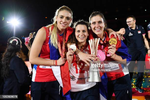 Jovana Stevanovic Teodora Pusic and Silvija Popovic of Serbia celebrate with the trophy after defeating Italy during the FIVB Women's World...