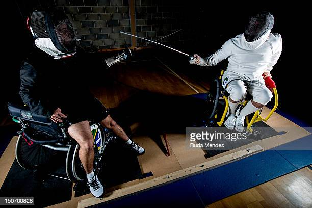Jovane Silva Guissone fights with his coach Eduardo de Vasconcelos during a fencing training session at the Brazil Paralympic team's camp in...