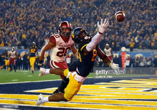 Jovani Haskins of the West Virginia Mountaineers can't make the catch against Robert Barnes of the Oklahoma Sooners on November 23 2018 at...