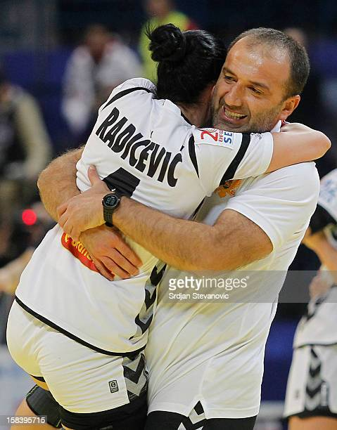 Jovanka Radicevic and head coach Coach Dragan Adzic of Montenegro celebrate victory against Serbia the Women's European Handball Championship 2012...