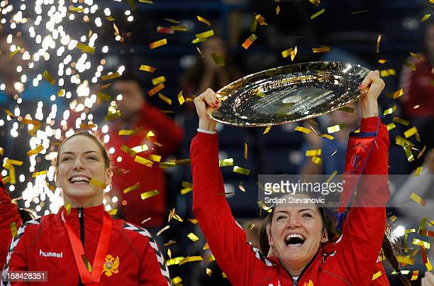 Jovanka Radicevic of Montenegro lifts the trophy during the Women's European Handball Championship 2012 medal ceremony at Arena Hall on December 16...