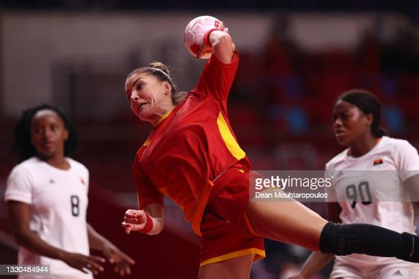 Jovanka Radicevic of Team Montenegro shoots and scores a goal during the Women's Preliminary Round Group A match between Montenegro and Angola on day...