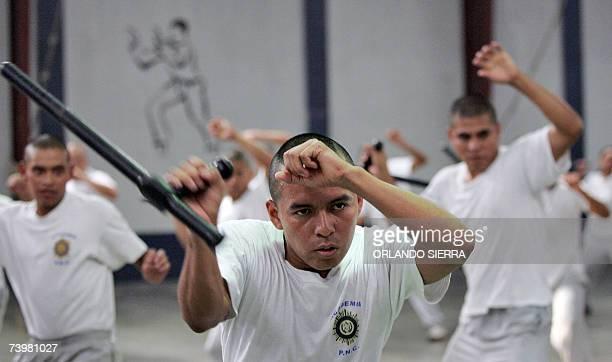 Jovenes de la decima octava promicion de la Academia de la Policia Nacional Civil practican tecnicas de manejo de baston en Ciudad de Guatemala el 20...