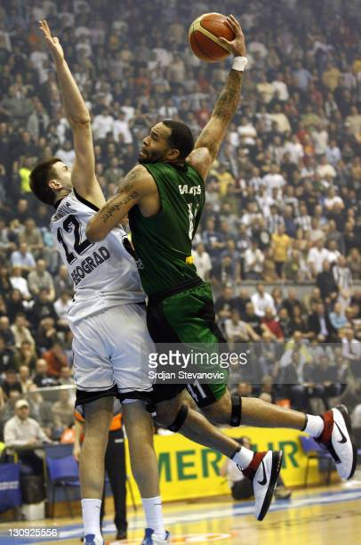 Joventut Badalona player Charles Gaines right tries to score over Novica Velickovic left from Partizan Belgrade during the TOP 16 group E Euroleague...