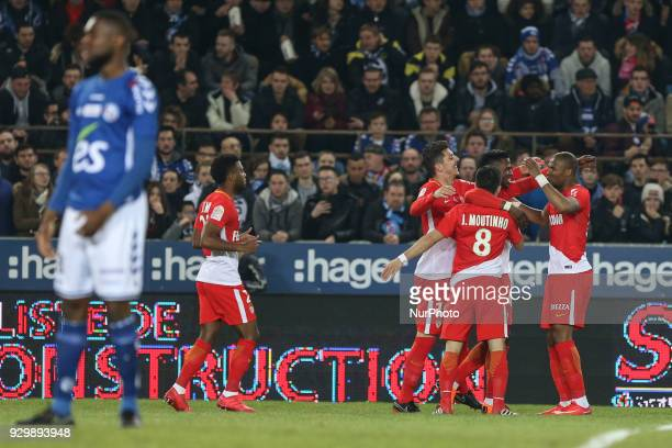 Jovetic Steven 10 celebrates with teammate during French Ligue 1 football match between Strasbourg and Monaco on March 9 2018 at the Meinau stadium...
