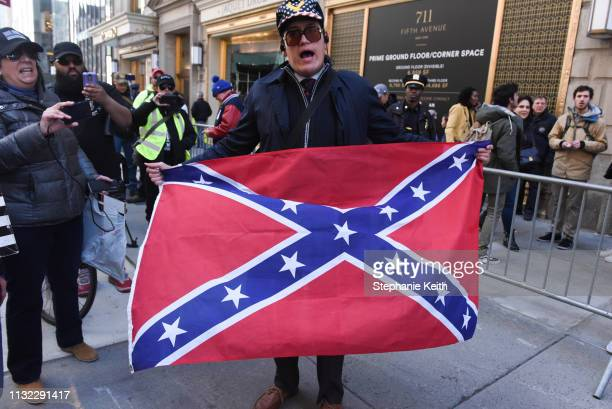 Jovi Val a local right wing activist holds a confederate flag during a rally in support of US President Donald Trump near Trump Tower on March 23...