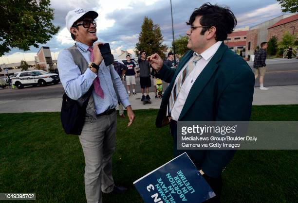 Jovi Val, left and Lucas, who declined to give his last name, argue before the Turning Point USA rally on the University of Colorado Boulder Campus...