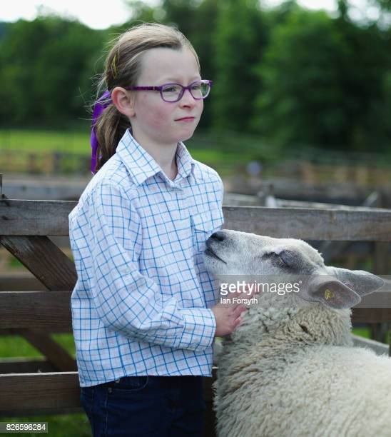 Jovi Wood from Stokesley stands with her blue domain cross Texel sheep during the Osmotherley Country Show on August 5, 2017 in Osmotherley, England....