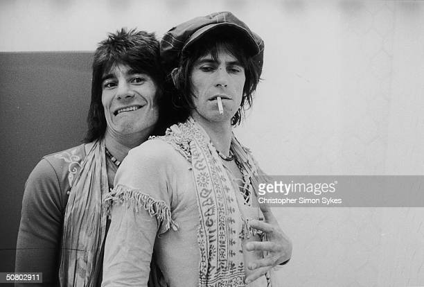 Jovial guitarist Ron Wood embraces his elegantly wasted colleague Keith Richards backstage during the Rolling Stones' 1975 Tour of the Americas.