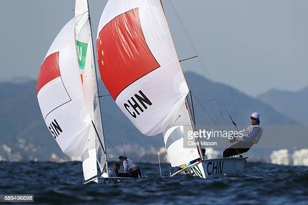 Jovina Choo of Singapore and Amanda Ng of Singapore and Lizhu Huang of China and Xiaoli Wang of China compete in the Women's 470 class on Day 9 of...
