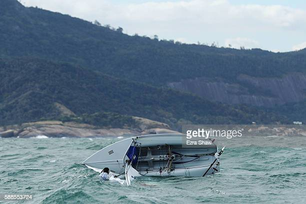 Jovina Choo of Singapore and Amanda Ng of Singapore capsize while competing in the Women's 470 class on Day 6 of the Rio 2016 Olympics at Marina da...