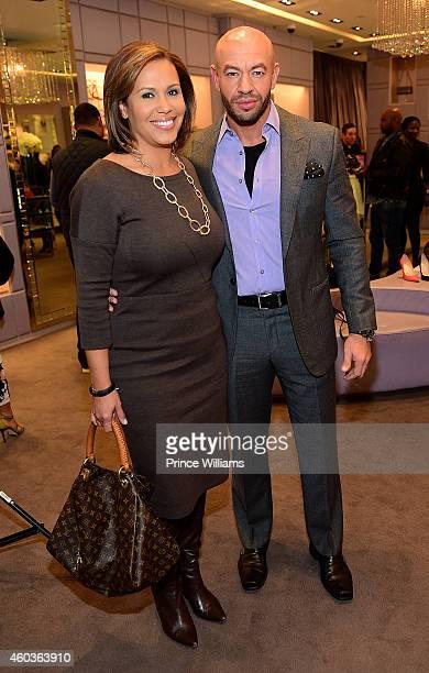 Jovita Moore and David Buer attend Jimmy Choo at Phipps Plaza on December 11 2014 in Atlanta Georgia