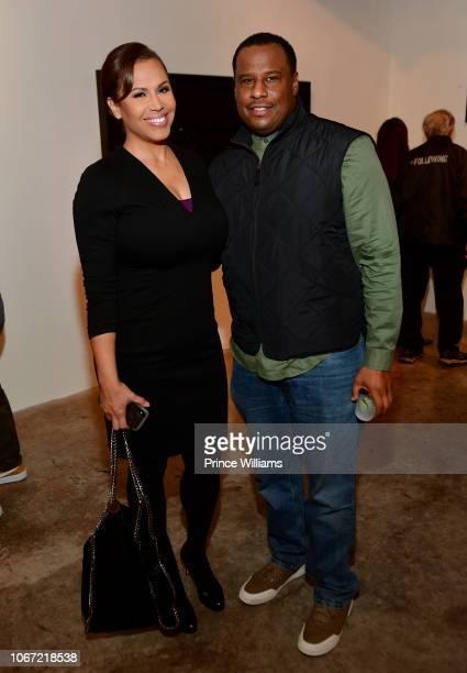 Jovita Moore and Marlon Nichols attend a DL Warfield Art Show at Westside Cultural Art Center on November 30 2018 in Atlanta Georgia