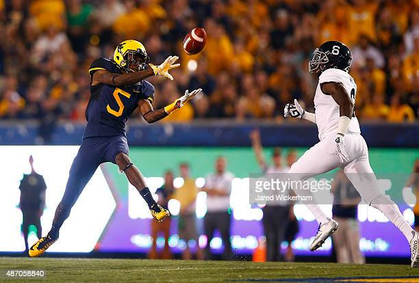 Jovon Durante of the West Virginia Mountaineers catches a pass in front of Dravon AskewHenry of the Georgia Southern Eagles in the first half during...