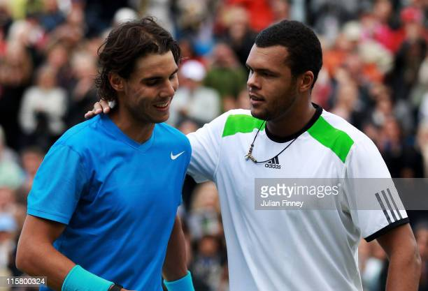 JoWilfred Tsonga of France and Rafael Nadal of Spain shake hands at the net after their his Men's Singles quarter final match on day five of the...