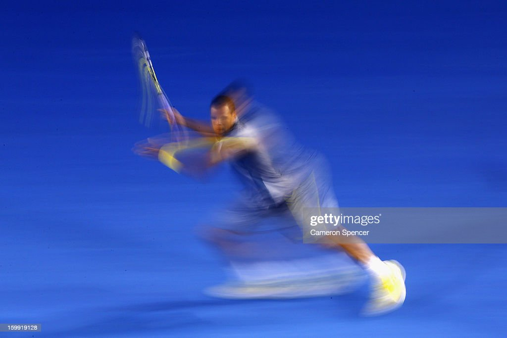 Jo-Wilfred Tsonga of France plays a forehand in his Quarterfinal match against Roger Federer of Switzerland during day ten of the 2013 Australian Open at Melbourne Park on January 23, 2013 in Melbourne, Australia.
