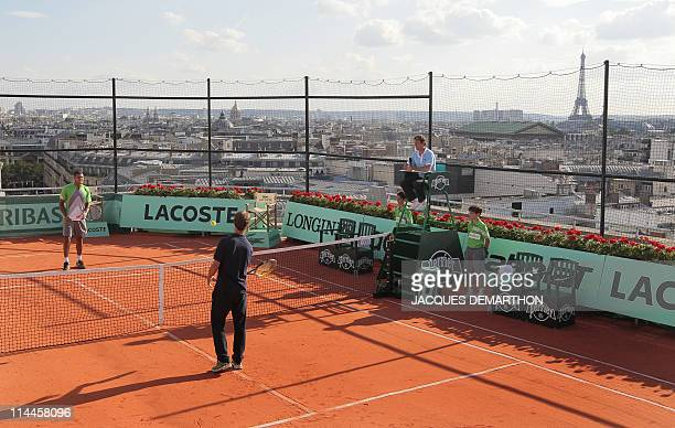 Jo-Wilfrid Tsonga of France and Richard Gasquet of France play an exhibition match, on May 19, 2011 on the roof of the Galeries Lafayette department...