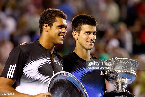 JoWilfried Tsonga of France and Novak Djokovic of Serbia pose for photographers with their trophies after the men's final match against JoWilfried...
