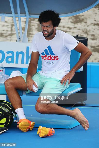 JoWilfried Tsonga of France appears to grimace while waiting for his foot to be treated during a practice session ahead of the 2017 Australian Open...