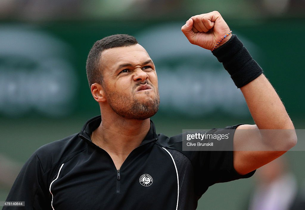 Jo-Wilfried Tsonga of France celebrates a point in his Men's Singles match against Pablo Andujar of Spain on day six of the 2015 French Open at Roland Garros on May 29, 2015 in Paris, France.